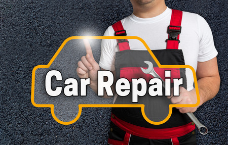 auto repair: car repair touchscreen is operated by auto mechanics. Stock Photo