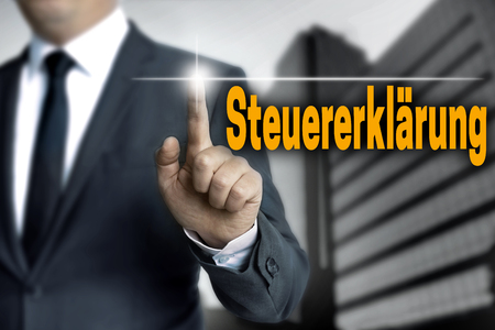touchscreen: steuererklaerung (in german tax declaration) touchscreen is operated by businessman