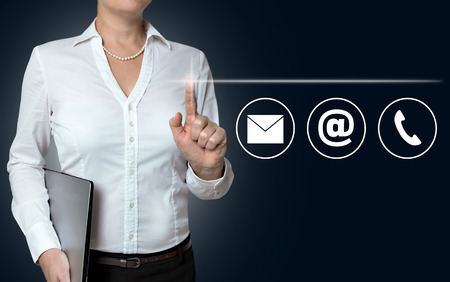 touchscreen: contact options touchscreen is operated by businesswoman.