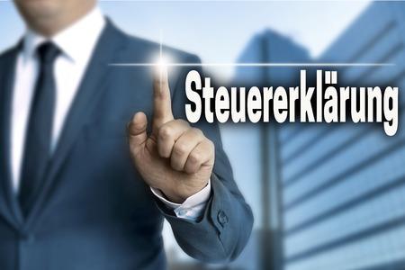 declaration: steuererklaerung (in german tax declaration) touchscreen is operated by businessman. Stock Photo
