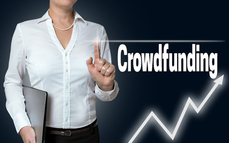 touchscreen: crowdfunding touchscreen operated by businesswoman. Stock Photo