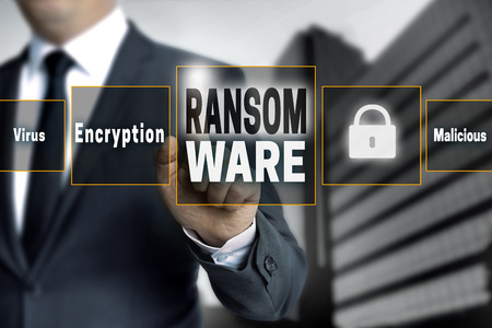 antivirus software: ransom ware touchscreen is operated by businessman.