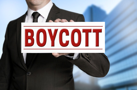 boycott: boycott shield is held by businessman.
