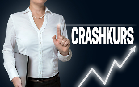 touchscreen: crashkurs (in german crash course) touchscreen is operated by businesswoman.