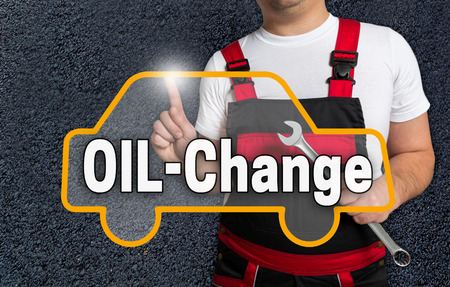 oil change: oil change touchscreen is operated by car mechanics.