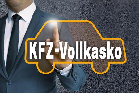 fully comprehensive: kfz vollkasko (in german car fully comprehensive) car touchscreen is operated by businessman concept.