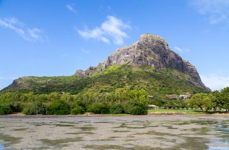 mauritius: Le Morne Brabant Mauritius with blue sky. Stock Photo