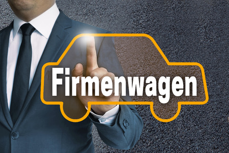 auto leasing: Firmenwagen (in german Company car) auto touchscreen is operated by businessman concept.