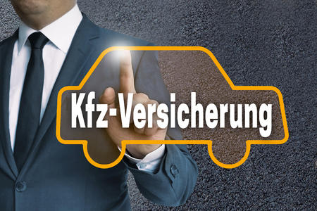 fully comprehensive: kfz versicherung (in german car insurance) auto touchscreen is operated by businessman concept. Stock Photo