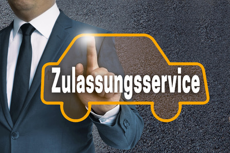 zulassungsservice (in german authorization service) car touchscreen is operated by businessman concept. Stock Photo