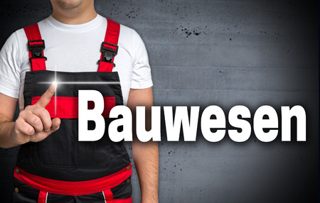 housebuilding: Bauwesen (in german construction industry) touchscreen is shown by the craftsman. Stock Photo