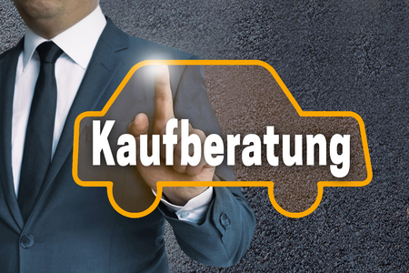 guides: Kaufberatung (in german Buying guides) auto touchscreen is operated by businessman concept.