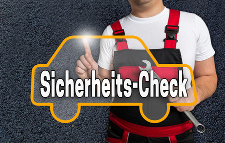 security check: Sicherheits-Check (in german security check) touchscreen is operated by car mechanics.
