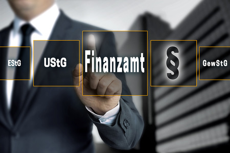 authorities: Finanzamt (in german Tax authorities, income, trade tax) touchscreen concept background. Stock Photo
