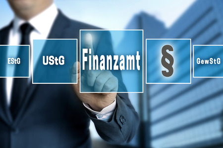 authorities: Finanzamt (in german Tax authorities, vat; income, trade tax) touchscreen concept background.