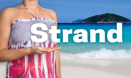 Strand (in german Beach) concept is presented by woman on the beach Stock Photo
