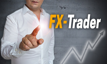 fx: fx trader touchscreen is operated by man. Stock Photo