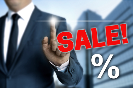 specials: Sale touchscreen is operated by businessman.
