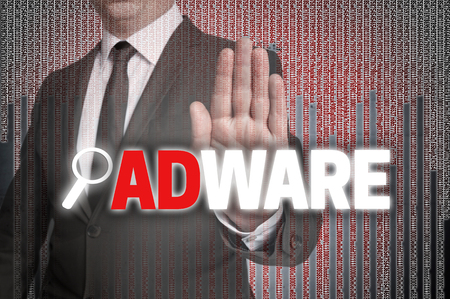 adware: Adware with matrix is shown by businessman.