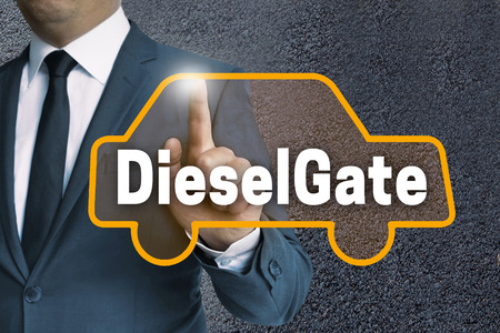 DieselGate auto touchscreen is operated by businessman concept.