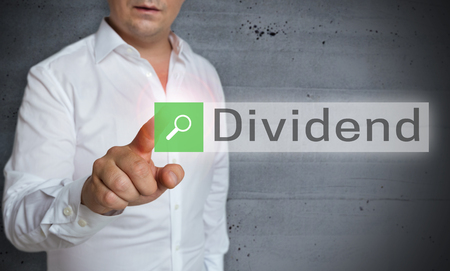 dividend: Dividend browser is operated by man concept. Stock Photo