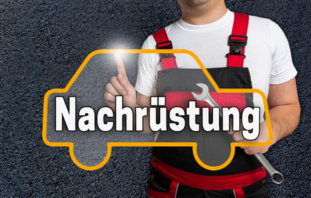 retrofit: nachruestung (in german retrofit) touchscreen is operated by car mechanics.