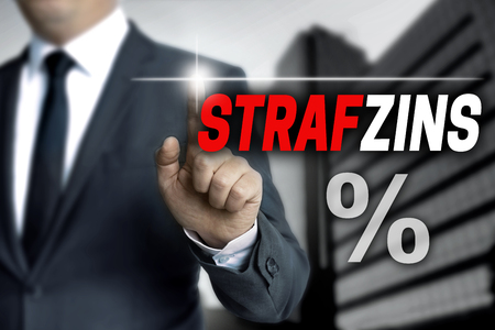 strafzins (in german negative interest) touchscreen is operated by businessman.