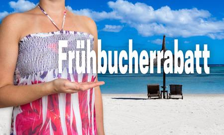 fruehbucherrabatt (in german early booking discount) concept presented by woman on the beach. Stock Photo