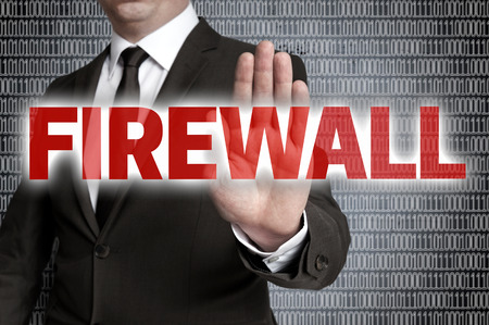 showed: Firewall with Matrix showed by businessman. Stock Photo