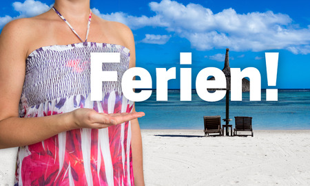 ferien: Ferien (in german Holiday) concept is presented by woman on the beach.