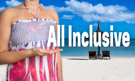 inclusive: all inclusive concept is presented by woman on the beach. Stock Photo