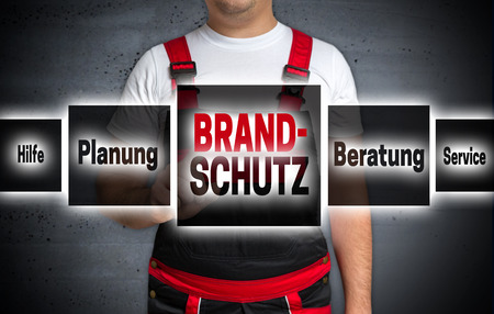 Brandschutz (in german Fire protection help planning advice) touchscreen is operated by craftsman.