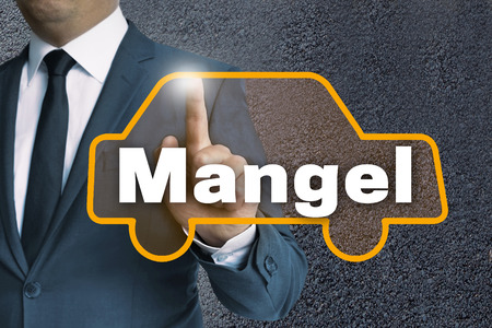 lack: mangel (in german lack) auto touchscreen is operated by businessman concept. Stock Photo