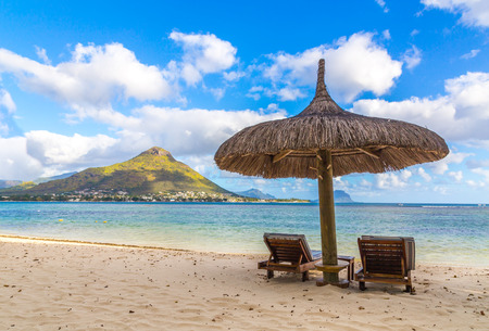 Sandy beach of Flic en flac Mauritius overlooking Tourelle du Tamarin. Reklamní fotografie - 65088979
