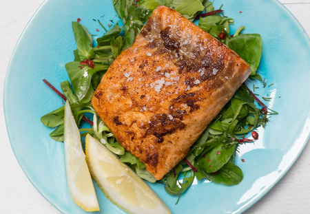 seperation: Fried salmon fillet with fleur de sel on mixed salad.