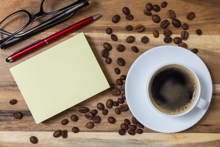 coffe break: Espresso with notepad concept Background on wood.