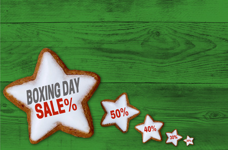 boxing day sale: Boxing Day Sale cinnamon star on green wood concept.