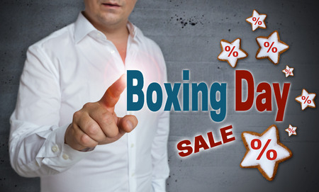 boxing day sale: Boxing Day Sale touchscreen is operated by man.
