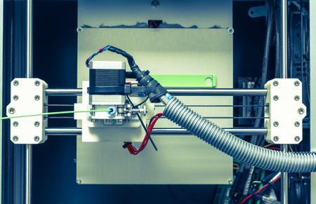 pla: 3d printer with bright green filament.