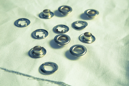 rivets: Hole rivets on canvas retro optic.