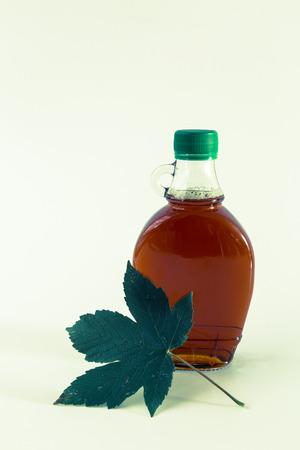 maple syrup: Isolated maple syrup in a bottle.