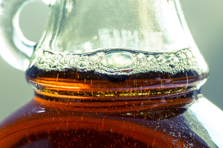 maple syrup: Maple syrup in a bottle in detail.