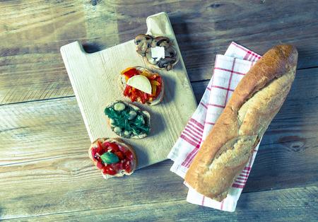 trillion: Bruschetta with beans and arugula, mushrooms, goat cheese.
