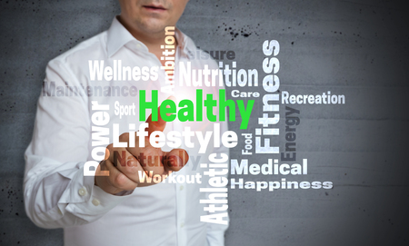 wordcloud: Healthy wordcloud touchscreen is operated by man.