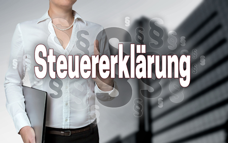 declaration: steuererklaerung (in german tax declaration) touchscreen is operated by businesswoman. Stock Photo