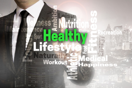 wordcloud: Healthy wordcloud touchscreen is shown by businessman.