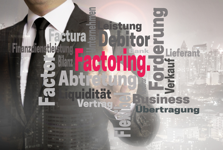 wordcloud: Factoring wordcloud touchscreen is shown by businessman. Stock Photo