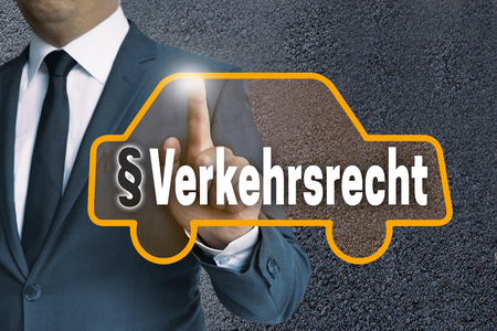 operated: Verkehrsrecht (in german Traffic law) auto touchscreen is operated by man concept.