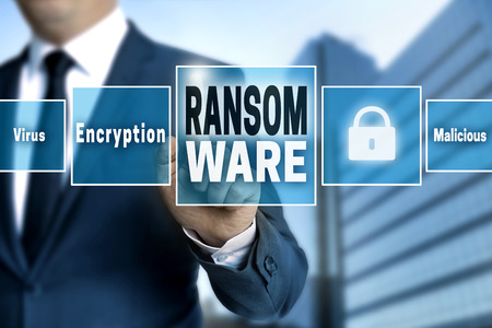 Ransomware touchscreen is operated by businessman. Reklamní fotografie