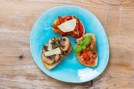 Bruschetta with tomatoes, mushrooms, goats cheese.